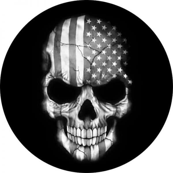This is a black tire cover with a skull image and a American flag inlaid in the skull in black and white.